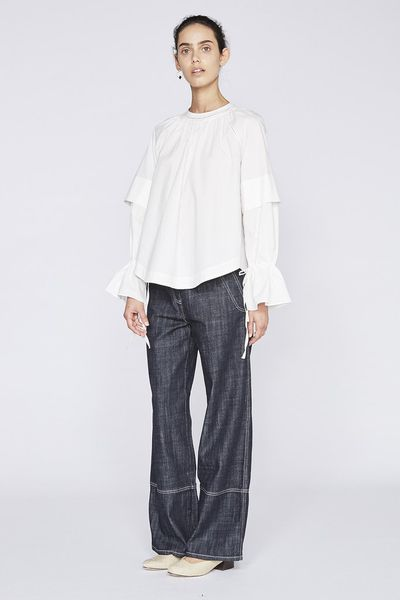 "Lee Mathews Boleyn shirt with ties at the back, $329 <a href=""https://leemathews.com.au/collections/tops/products/boleyn-cotton-shirt-with-ties-natural?variant=34664222226"" target=""_blank"">pre-order<br /> </a>"