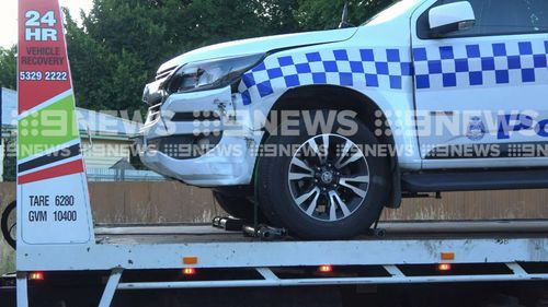 A police vehicle is towed away from a street in Delacombe , Ballarat