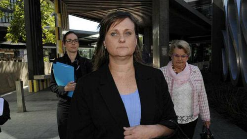 Emma Driscoll, the wife of disgraced Queensland MP Scott Driscoll, leaves the Magistrates Court in Brisbane after being committed to stand trial. (AAP)