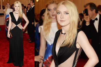 Dakota Fanning looks fierce in a Rodarte gown at the MET Gala in NYC.