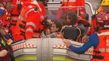 A family were rescued from floodwaters on the Hawkesbury River today twice, after an SES boat capsized.