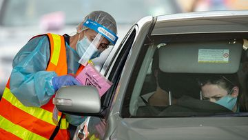 Medical professionals conduct COVID-19 tests at a drive through testing clinic in Shepparton.