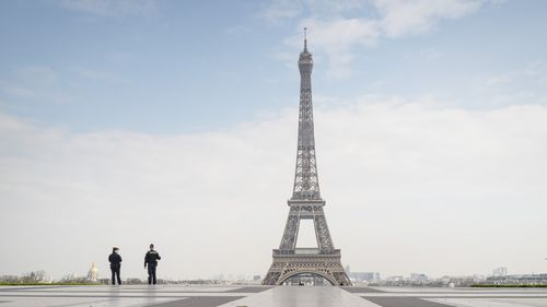 Police patrol an isolated Eiffel Tower