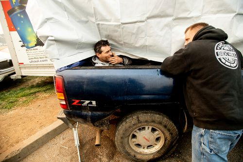 Eric Bass, left, and Troy Bledsoe, evacuees of the Camp Fire, spend time at a makeshift shelter.