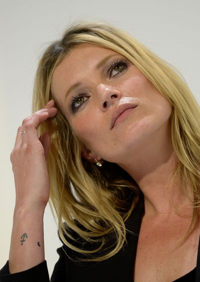 Kate Moss also has two swallows tattooed at the base of her spine by Lucien Freud.