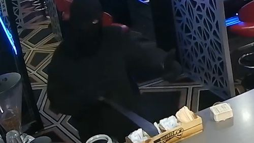 The robber was wearing a balaclava and armed with a machete.