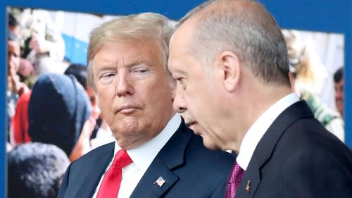 A file photograph of US President Donald Trump talking to Turkish President Recep Tayyip Erdogan as they tour the new NATO headquarters in Brussels, Belgium.