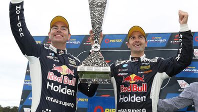 Craig Lowndes and Jamie Whincup celebrate their Sandown 500 victory.