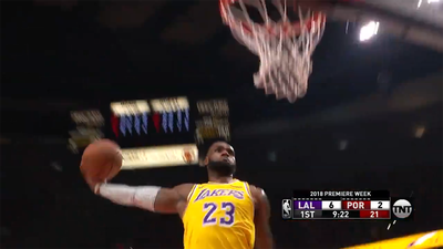 LeBron James starts life as a LA Laker with stunning double dunks