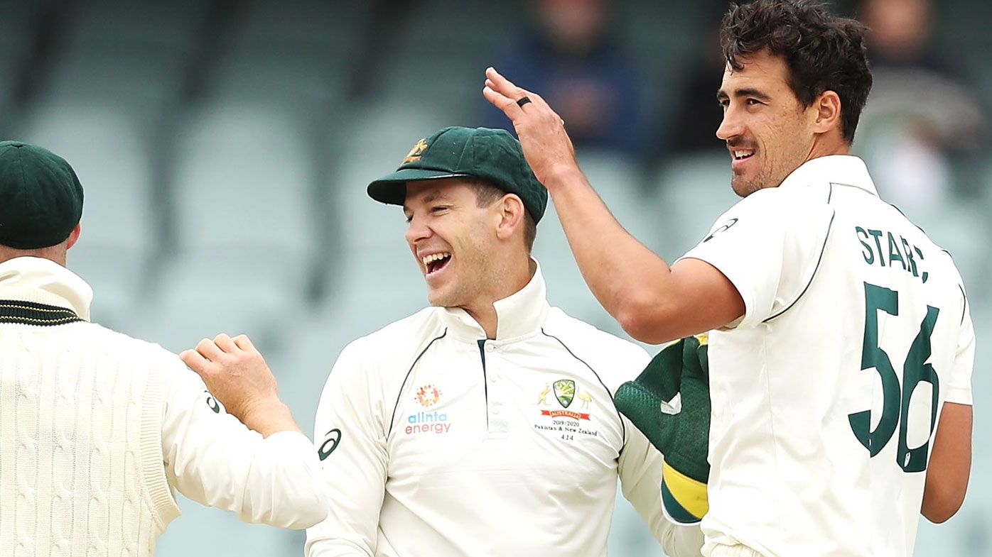 Mitchell Starc of Australia celebrates with his team mates after taking the wicket of Shaheen Shah Afridi