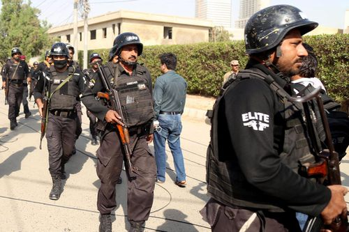 Among those dead were two Pakistani civilians, two police officers and all three assailants, including one who was wearing a suicide vest, Pakistani officials said.