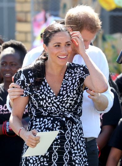 CAPE TOWN, SOUTH AFRICA - SEPTEMBER 23: Meghan, Duchess of Sussex smiles as she visits a Justice Desk initiative in Nyanga township, with Prince Harry, Duke of Sussex, during their royal tour of South Africa on September 23, 2019 in Cape Town, South Africa. The Justice Desk initiative teaches children about their rights and provides self-defence classes and female empowerment training to young girls in the community. (Photo by Chris Jackson/Getty Images)