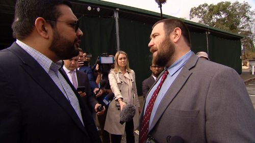 Islamic Council spokesman Ali Kadri confronts Mr Robertson after he arrived at a mosque.