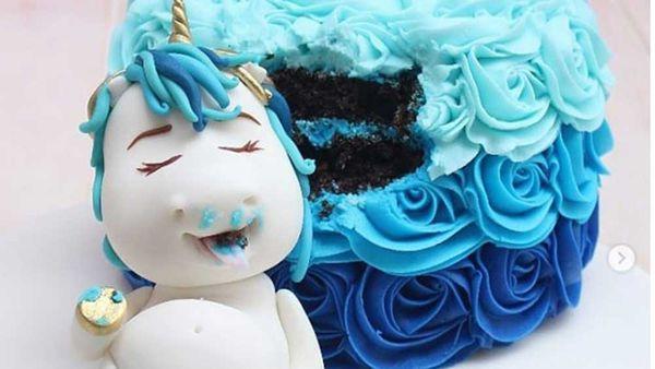Unicorn sleeps on cake