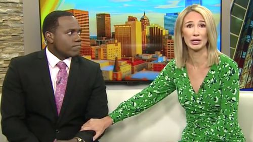 """Oklahoma morning TV anchor Alex Housden said a gorilla at the city zoo """"kind of looks like you"""" to her colleague, Jason Hackett, at the end of a feature on KOCO-TV."""
