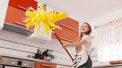 Kitchen duty: If you say that one more time I'm going to hit you with this mop. Image: Getty