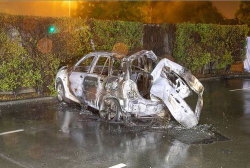 The stolen car the three teens were in, burst into flames when it crashed after hitting police road spikes.