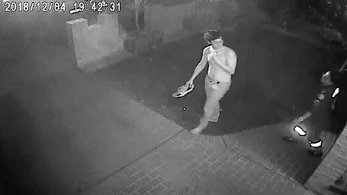CCTV shows the injured man being treated by paramedics at a nearby premises.