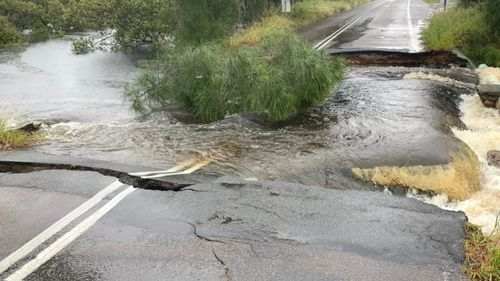An image of a cracked road in Port Stephens after heavy rain.