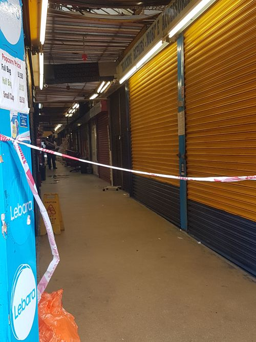 Police tape at the Reliance Arcade between Brixton Road and Electric Lane in south London, where a young woman who was was attacked with a noxious substance. (AAP)