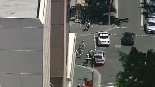 Sydney CBD building fire forces closure of Sussex Street