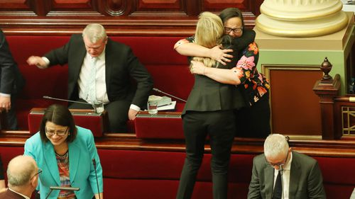 Victorian MPs show emotion after the Voluntary Assisted Dying Bill 2017 passed in the Victorian Legislative Council in Melbourne, Wednesday, November 22, 2017.