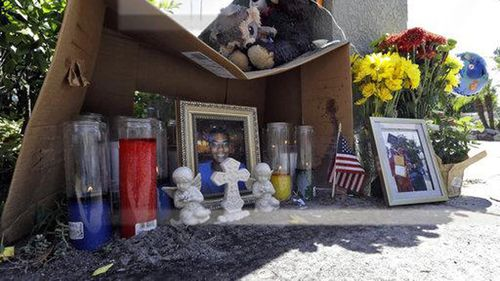 A makeshift memorial for shooting victim Anthony Naiboa sits on a sidewalk in the Seminole Heights section of Tampa, Fla., Tuesday, Oct. 24, 2017. Similar murders have occurred in the neighborhood in the span of two weeks leading fears of a possible serial killer. (AP Photo/Chris O'Meara)