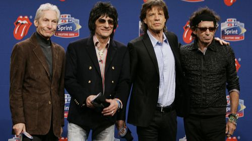 Members of the Rolling Stones, from left, drummer Charlie Watts, guitarist Ron Wood, singer Mick Jagger, and guitarist Keith Richards. pose for photographers after arriving for a Super Bowl news conference in Detroit on Feb. 2, 2006.