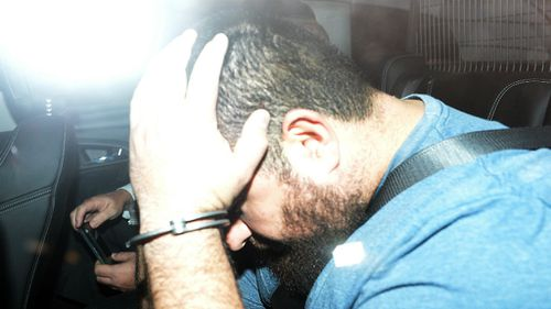 Omar Succarieh is brought to the Brisbane Police Watchhouse, Wednesday, Sept 10. (AAP)