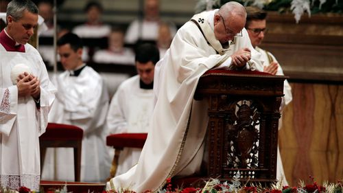 Pope Francis (R) celebrates Midnight Mass of Christmas on the Solemnity of the Nativity of the Lord in Saint Peter's Basilica at the Vatican. (Image: AAP)