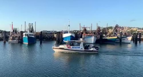 A police boat moves into Coffs Harbour after a so-far unsuccessful search for the two missing fishermen.