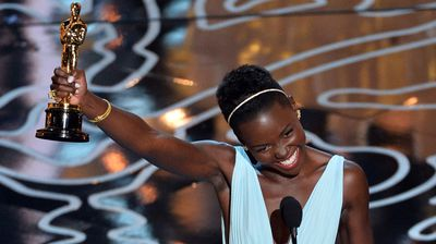 Lupita Nyong'o shines as she accepts her Best Supporting Actress award for 12 Years a Slave.