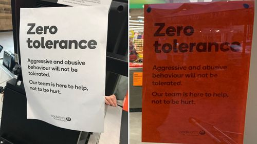 Signs in Woolworths stores urging customers not to abuse staff.