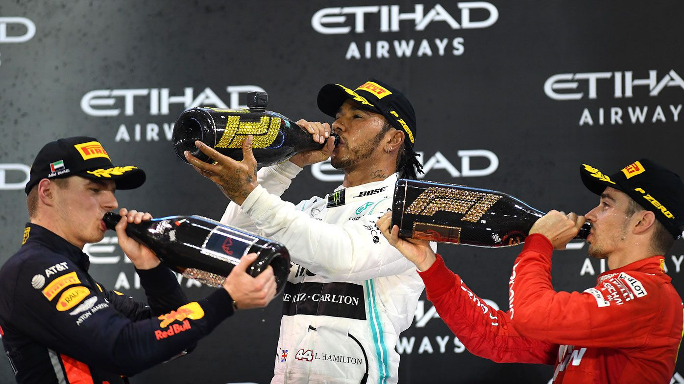 Top three finishers Lewis Hamilton of Great Britain and Mercedes GP, Max Verstappen of Netherlands and Red Bull Racing and Charles Leclerc of Monaco and Ferrari celebrate on the podium