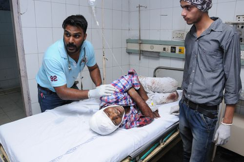 A person who was injured in the train accident undergoes treatment at a hospital in Amritsar.