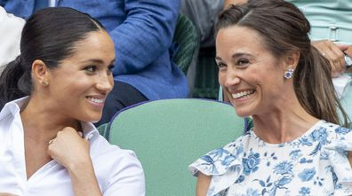 Catherine, Duchess of Cambridge and Meghan, Duchess of Sussex and Pippa Middleton in the Royal Box at Wimbledon on July 13, 2019 in London, England.