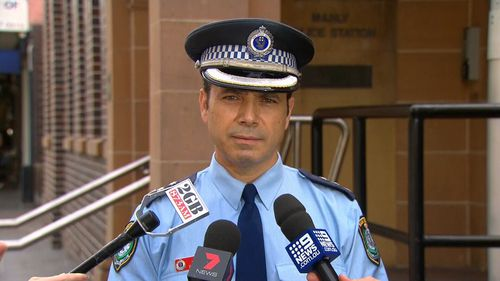 Detective Inspector Michael Boutouridis addresses the media outside Manly Police Station.