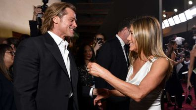 Brad Pitt and Jennifer Aniston cross paths on the SAG red carpet.