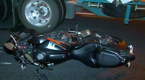 A motorbike rider has died after he collided with a car and a truck in Melbourne's west. Picture: 9NEWS