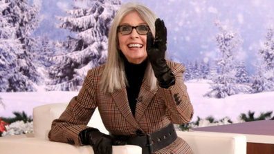 Diane Keaton flirts with male audience members.