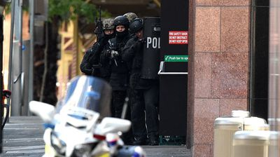 NSW Public Order and Riot Squad Police are seen on Phillip Street in the central business district of Sydney. (AAP)