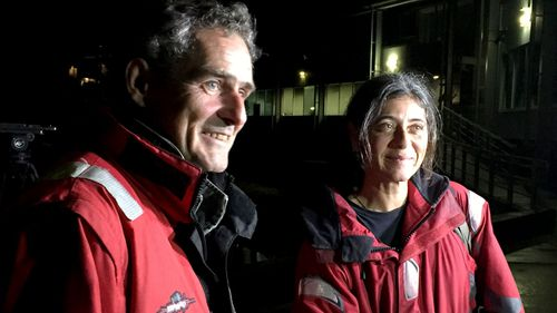 Nick Dwyer and Barbara Heftman arrive in Sydney after their yacht's rudder broke in treacherous conditions and they were rescued by NSW Police. (AAP)