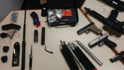 Numerous weapons and replica firearms were found in the raids.