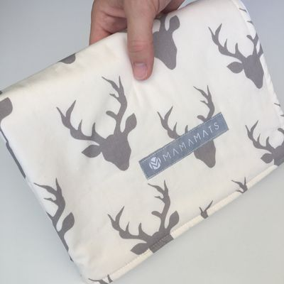 """<a href=""""https://www.etsy.com/au/listing/495391414/portable-waterproof-baby-change-mat-deer?ref=shop_home_active_3"""" target=""""_blank"""">Mama Mats Portable Waterproof Changing Mat, $33.</a>"""
