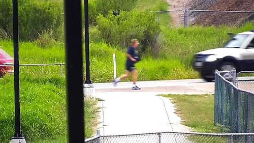 Neil Bennett is seen running down a road before his death.
