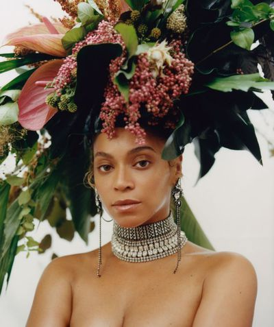 <p>Beyoncé wears a floral headdress by Phil John Perry for Rebel Rebel, Erickson Beamon earrings and Lynn Ban necklaces <em>US Vogue </em>September 2018</p> <p> </p>