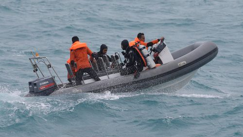 Indonesia expands search for AirAsia bodies