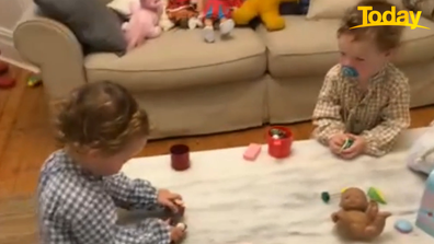 After saying 'Hi' to their Dad, the twins returned to their tea party.