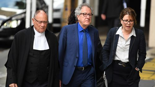 Australian actor Geoffrey Rush (centre) arrives at the Federal Court in Sydney Monday, October, 22, 2018.