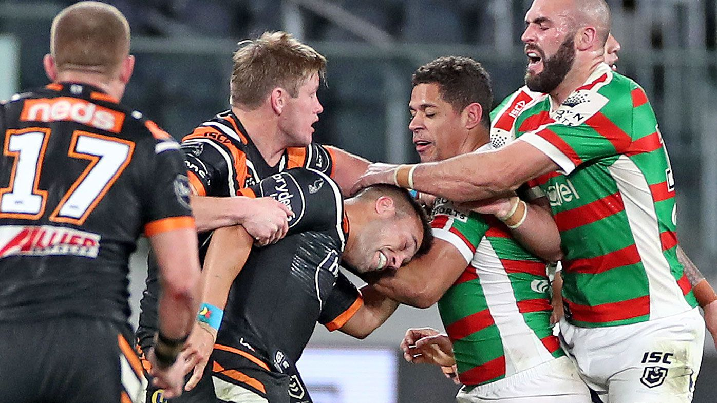 Luke Brooks of the Tigers and Dane Gagai of the Rabbitohs scuffle
